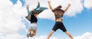 2 people jump high