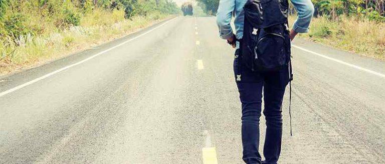 woman walking along road 2