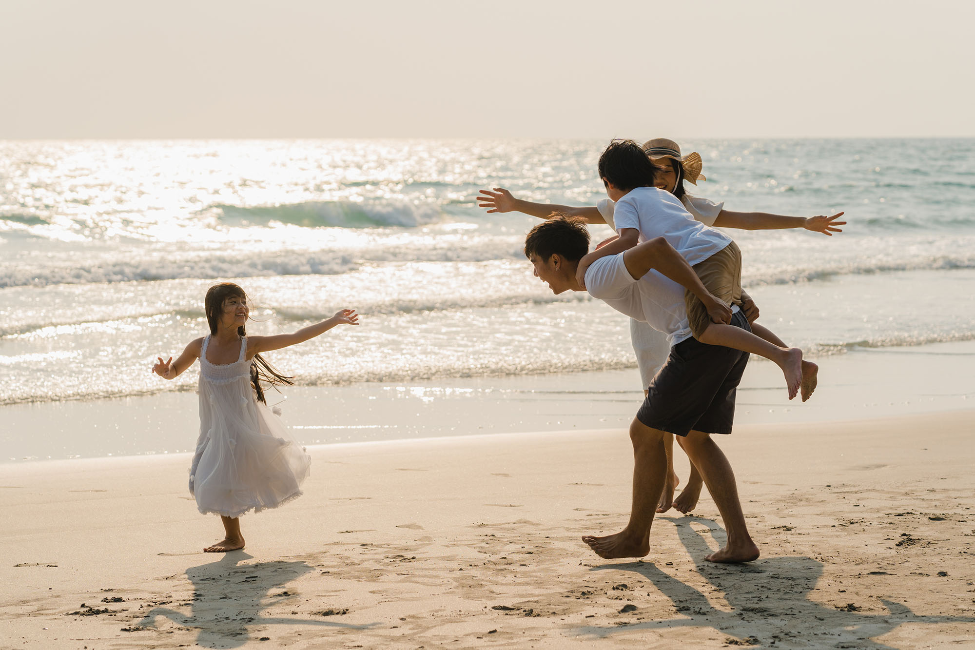 happy family playing together near the sea