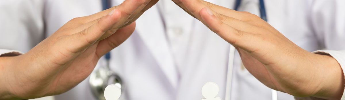 Doctor's hands posing home symbol