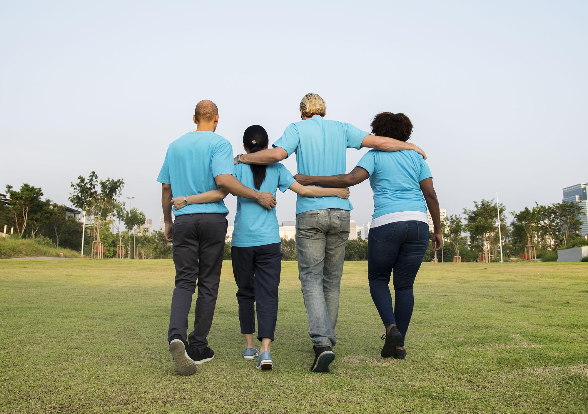4 people walking together