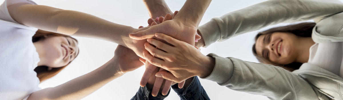4 people join hands bottom view