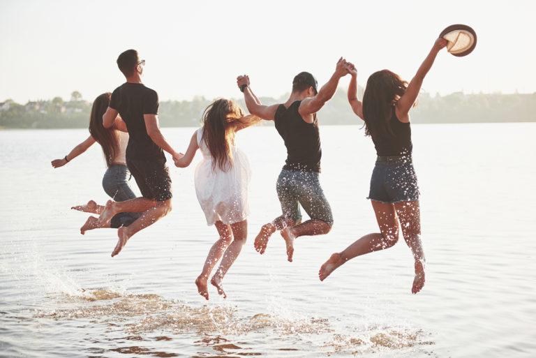young people having fun in the beach