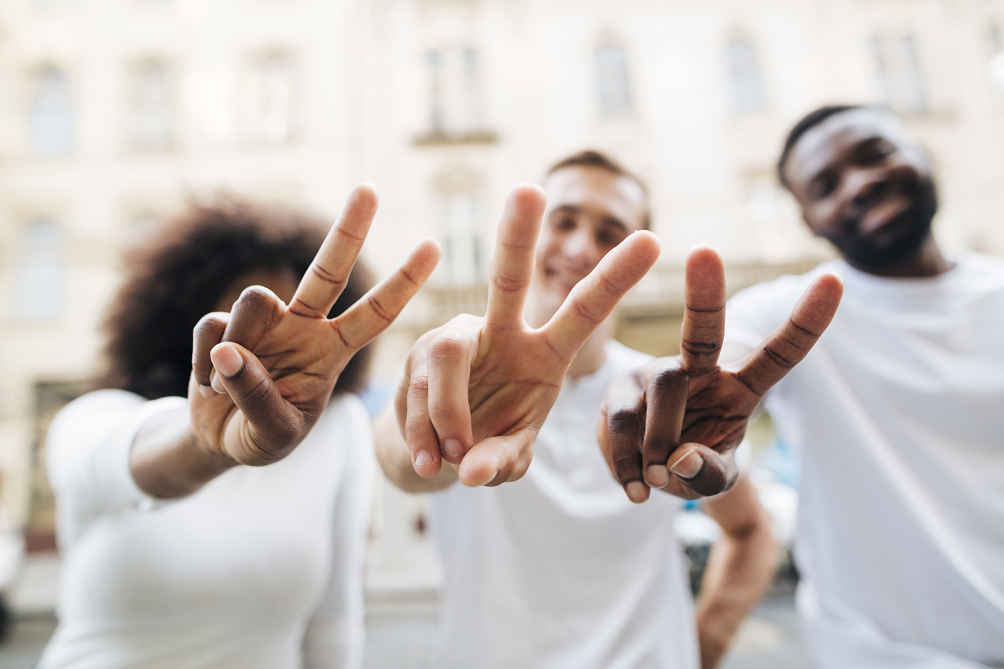 friends showing peace sign