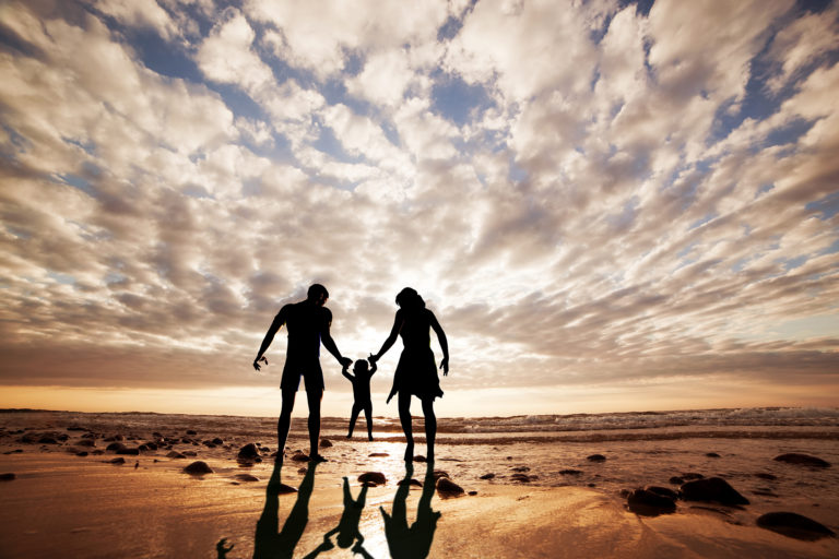 silhouette family playing beach