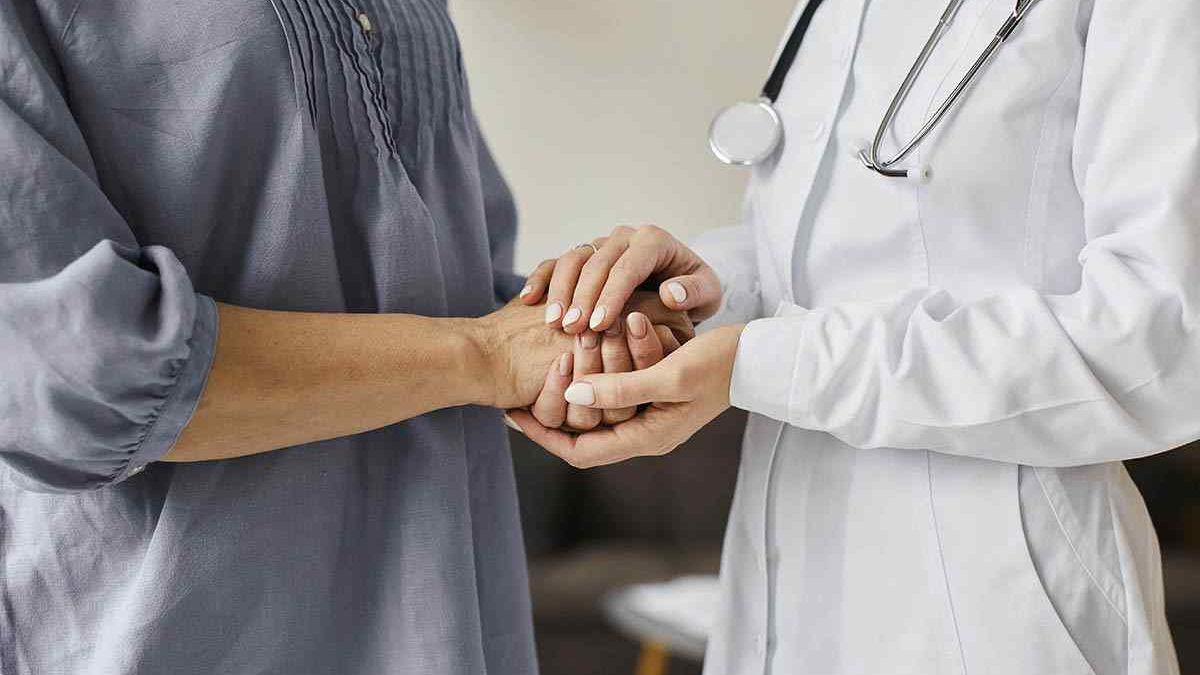 covid-recovery-center-female-doctor-holding-older-patient-s-hands