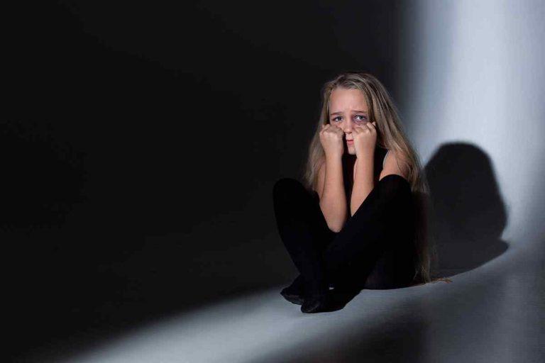 sad-frightened-little-girl-with-bloodshot-bruised-eyes-crying-scared