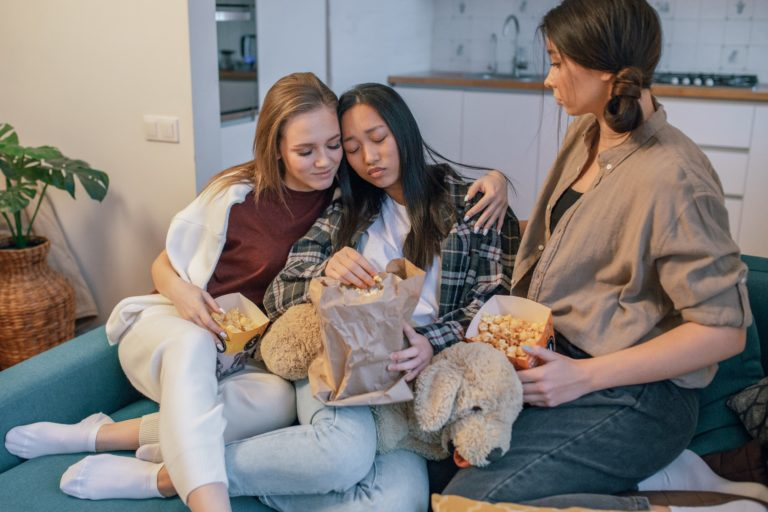 three women sitting in the sofa