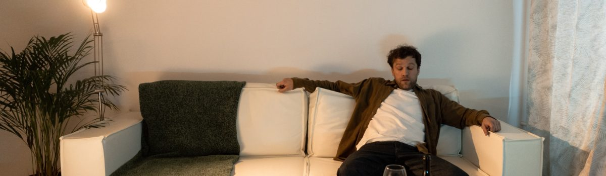 men sitting in the sofa